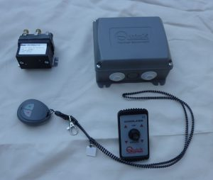 he electrical system supplied comprises of:  (top left clockwise):  Changeover contactor (12 V DC),   Radio receiver,   Deck switch used as an alternative to the remote,   Pushbutton remote control   with  necklace and pocket clip.